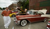 Roger Gibbs poses with his 1956 Chevy Bel Air HT at the annual Brookfield Chamber of Commerce Car and Bike Show.
