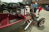 Jim Bergthold, right, talks with his son David, left, about engine design on a 1923 Ford Roadster at the annual Brookfield Chamber of Commerce Car and Bike Show.