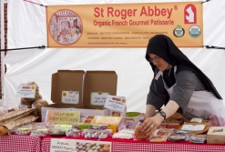 Sister Mary Valeria of St. Roger Abbey, Vernon Hills,IL., arranges pastries at the Brookfield farmers market.