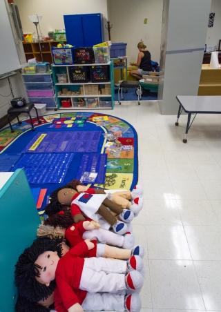 Pamela Lawrence, an early childhood teacher, organizes school materials at Willard School.