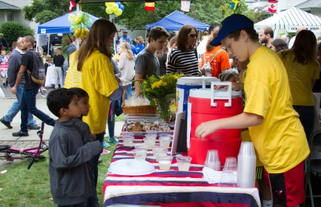 Aryan and Ashym Patel, left, get their lemonade from Jake Birmingham during 9.11 LemonAid event on Bonnie Brae in River Forest.