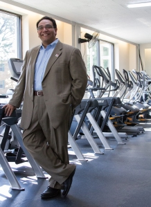 West Cook YMCA CEO Philip Jimenez poses in the organization's newly renovated cardio room on September 3, 2015.