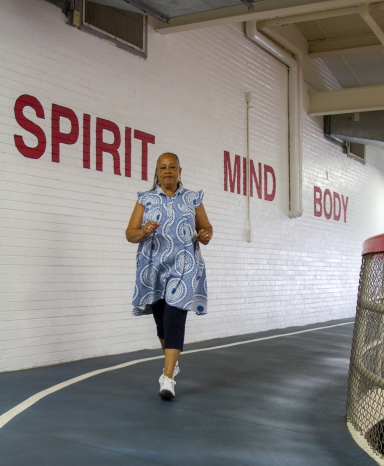 "Yolanda Wynn, a West Cook YMCA member, walks around the facilities' indoor track on September 3, 2015. Wynn calls the Y ""a blessing spiritually and health wise."""