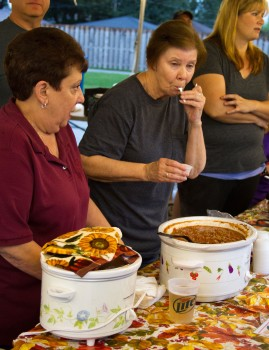Ellen Soriver does a quality check of the chili made by her group, the North Riverside Administration.