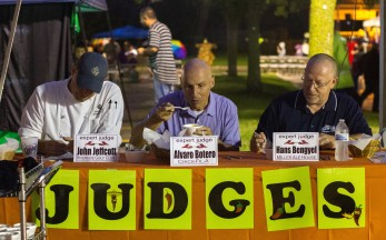John Jeffcott, left, Alvaro Botero, center, and Hans Bengyel, right, judge chili entries.